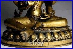 Antique bronze buddha statue depicts four arms deity seated in royal ease 19th