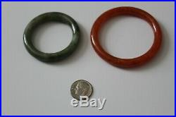 Two Chinese Imperial period children's Jade bangles from prominent estate